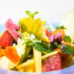 Spectacular fruit salad: Mix of season fruits with fruit ice-cream and frozen mint