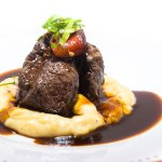 Sirloin of beef, potato parmentier, roasted peppers and demiglace