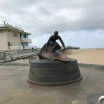 Beach sculpture of the SURFER at Hermosa Beach