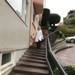Steps with handrail walking down Lombard St