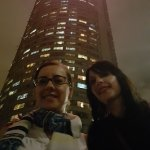 Standing in front of Ponte City at night.