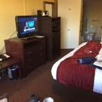 Very large room. King size bed, tv, Frig, MW, work table. no light by table to do work