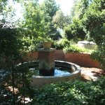 a water feature in the well-established garden