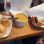 Garlic butter rolls, crab bisque, crab cakes and crab leg