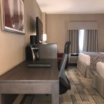 Our newly renovated Classic Room with 2 double beds, mini-fridge, and bath-shower