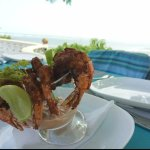 Deep-fried prawns with an ocean view backdrop