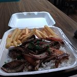 Steak, rice, and french fries from food truck