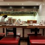 Counter and table seating at open kitchen