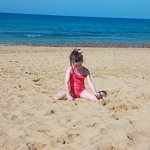 My granddaughter at golden bay early in the morning