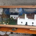 A mini-display of the village under glass