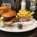 The Works Burger with onion rings..........partner loved it.
