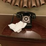 Fake rotary phone on second floor. The used tissue is a nice touch.