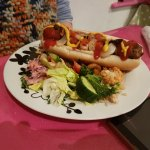 Vegan hot dog with onions, ketchup and mustard