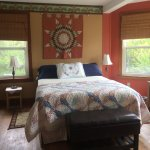 Quilt room with queen bed, sitting area, private bath, ocean view