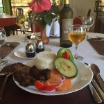 An authentic African dish and Tanzania wine served at Mbalamwezi restaurant