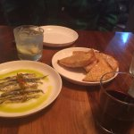 Appetizer: white anchovies and olive oil toast