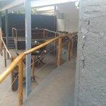 Área externa da nossa Pizzaria, vista do acesso ao cadeirante.