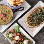 appetizers from our dinner menu roasted root veggie salad, cheesy spinach dip, & greens on flatb