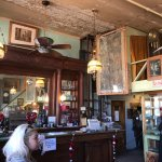 """Original bar and other pieces. I like that they've keep the """"worn down"""" look of the place."""