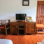 Table, minibar and TV