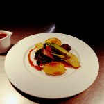 Pan fried duck breast with Chinese spices, stir fry vegetables and plum sauce