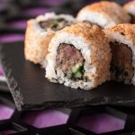 Spicy tuna roll coated in a dusting of mild Japanese chilli mix