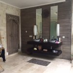 Large outdoor (yet covered) bathroom with double vanities