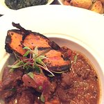 A moist slow cooked lamb stew with rosemary roast potatoes and spinach