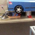 Hard at work replacing a muffler