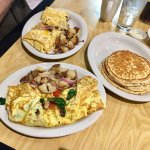 Veggie omelette with stack of pancakes and Texas omelette