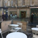 Empty tables outside, weather related!