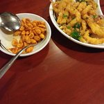 Tough chewy calamari , overload of batter and stale peanuts!
