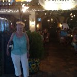 Judi outside restaurant happy after delicious meal.