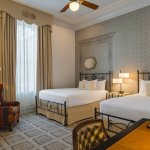 Standard guestroom with 2 queen beds at The Driskill in downtown Austin.