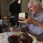 Quaffing a delightful NZ Otago Pinot Noir with my perfectly served rib eye!