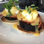 Poached eggs with bacon and haggis toast
