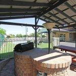 Guests BBQ area adjacent renovated salt water pool