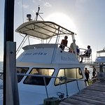Our Dive Boat - Holiday Diver - and its captain Therese on top