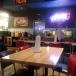 condiment and topping counter at rear of Fuddruckers