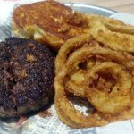 a 2/3 lb. burger with onion rings