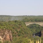 The view of the bridge and the Falls from the back of the Victoria Falls Hotel