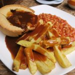 Steak and Guinness pie with chips and gravy