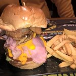 Classic cheese burger with bacon and fried onion served with french fries