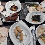 hummus, feta cheese rolls, grape leaves roll, meat balls, ...