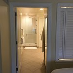 Hall from room to bathroom, shutters over tub closed