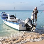A local fisherman arriving with the day´s catch