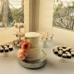 Rustic wedding cake and dessert table