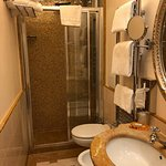 Lovely bath with multi-directional shower heads. Warming rack for towels and nice amenities.