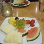 Fruit salad and complimentary fizz.