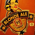 Blonde Ale sign on wall in side room